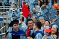 New degree holders wave Chinese flags during the 2018 graduation ceremony at Columbia University, New York. Photo: Xinhua