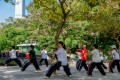 Tai chi practitioners in Kowloon Park. Photo: Alamy