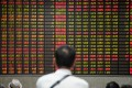 The Shanghai Composite has run up more than 10 per cent in gains this year. Above, traders look at stock prices at a brokerage house in Shanghai on July 6, 2018. Photo: Reuters