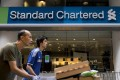 Standard Chartered, which is set to report its full-year results on Tuesday, said it was 'considering its options' in relation to the notice. Photo: AFP