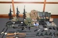 Law enforcement officers seized 15 guns and 1,000 rounds of ammunition from his home. Photo: AFP