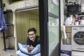 Adriel Tjokrosaputro rents a windowless bed space for less than HK$3,500 a month. Photo: K.Y. Cheng