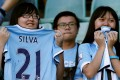 Fans watch Manchester City training in Shenzhen in 2016. Photo: Reuters