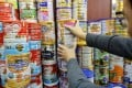 Tins of infant powder formula are seen at a pharmacy in Sheung Shui. 11DEC13