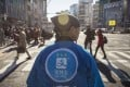A staff member wearing a uniform featuring the logo for Ant Financial Services Group's Alipay, an affiliate of Alibaba Group Holding, during a campaign event in Tokyo on December 9, 2017. Photo: Bloomberg