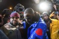 R. Kelly surrenders to authorities at a Chicago police station. Photo: Chicago Sun-Times via AP