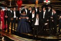 """Producers of Best Picture nominee """"Green Book"""" Peter Farrelly and Nick Vallelonga accept the award for Best Picture with the whole crew on stage during the 91st Annual Academy Awards at the Dolby Theatre in Hollywood on Sunday, February 24, 2019. Viggo Mortensen is the first on the left, while Mahershala Ali in fourth from the left. Photo: Agence France-Presse"""