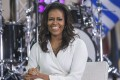 Former first lady Michelle Obama is said to be an advocate of collagen, could that what gives her skin its glow? Picture: AP