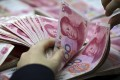 Villagers said their signatures had been used to apply for almost 100 million yuan (US$15 million) in loans. Photo: AP