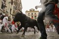 The running of the bulls is shown at the San Fermin fiestas in Pamplona in northern Spain on July 8, 2012. China's bull market began quickly, raising questions about how long it can last. Photo: Associated Press