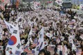 Protesters wave South Korean and US flags during a rally denouncing South Korean President Moon Jae-in in Seoul in November 2018. Moon's once sky-high approval ratings have fallen to earth over the country's economic performance, and his support for negotiations between Donald Trump and Kim Jong-un have not paid off so far. Photo: AP