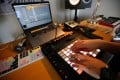 Sarouna, a Palestinian DJ, works on a music track at her home in the West Bank city of Ramallah. Photo: Abbas Momani/AFP