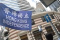 Hong Kong independence supporters gather near the Foreign Correspondents' Club during a talk by the separatist Hong Kong National Party's convenor Andy Chan on August 14, 2018. Hong Kong authorities banned the party the following month. Photo: EPA