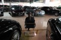 A sales representative waits for customers in a luxury car showroom in Beijing on January 22, 2019. Photo: Agence France-Presse