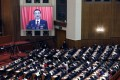 Chinese Premier Li Keqiang appears on a screen as he speaks during the opening of the second session of the 13th National People's Congress outside the Great Hall of the People in Beijing. Photo: EPA