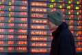 An investor checks out stock prices in Nanjing on March 4, 2019. In China, red signals gains. Photo: Xinhua