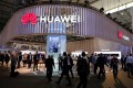 Visitors walk next to Huawei booth at the Mobile World Congress in Barcelona, Spain on February 27. Photo: Reuters