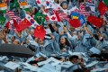 Chinese and other international students wave flags at a Columbia University commencement ceremony last year. Photo: Xinhua