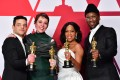 Oscar award winners Rami Malek (best actor), Olivia Colman (best actress), Regina King (best supporting actress) and Mahershala Ali (best supporting actor) pose with their statuettes during the 91st Annual Academy Awards in Hollywood, California, on February 25. The Oscar's award line-up has grown more diverse over the years. Photo: AFP