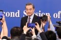 Chinese Foreign Minister Wang Yi arriving at Friday's press conference in Beijing. Photo: Simon Song