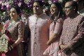 Reliance Industries Chairman Mukesh Ambani, right, with, from left, his wife, Nita, his son, Akash, and his daughter, Isha, arriving for Akash's wedding in Mumbai, India, on Saturday. Photo: AP