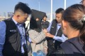 Guangdong provincial police prepare to hand over a fugitive to their counterparts in Hong Kong at the Huanggang port in Shenzhen in December 2018. Photo: Hong Kong Police