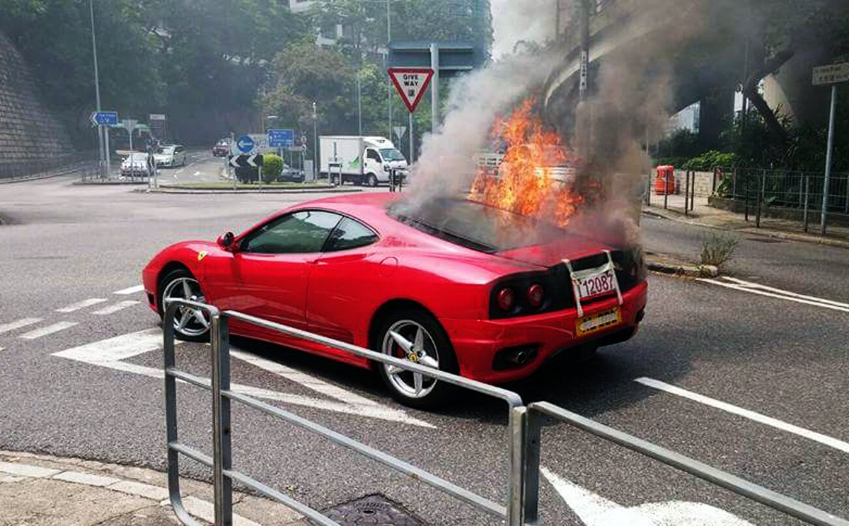 a3018f9c41f Moment Ferrari bursts into flames on Hong Kong street en route to vehicle  inspection | South China Morning Post