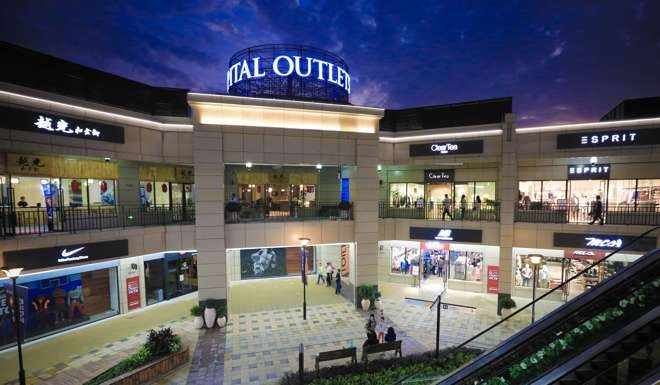 Outlet malls booming in China as department stores feel the pinch