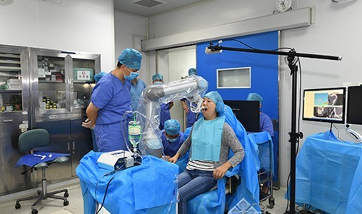 Chinese robot dentist is first to fit implants in patient's