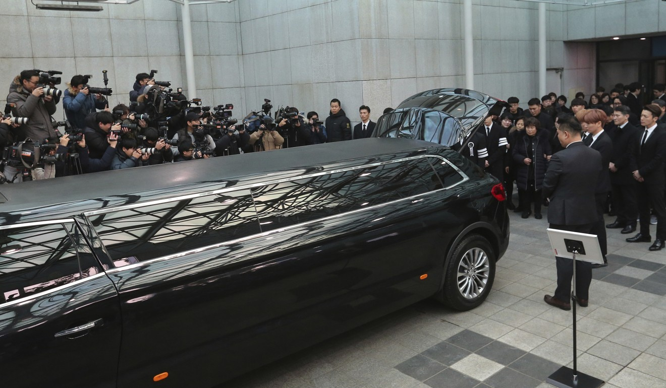 Hundreds of tearful fans weep as coffin of K-pop star