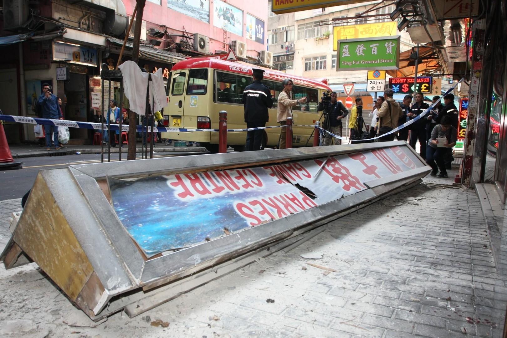 Hong Kong police arrest business owner after sign falls