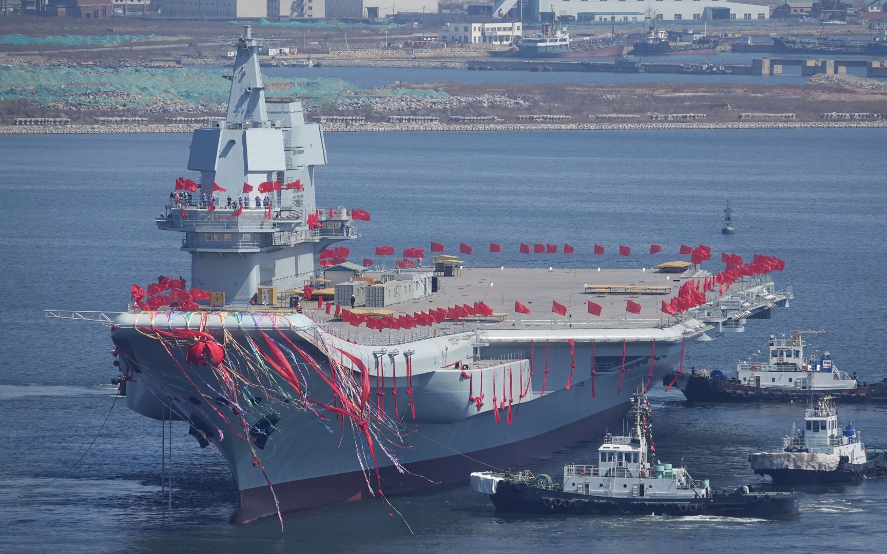 China has started building its third aircraft carrier, military