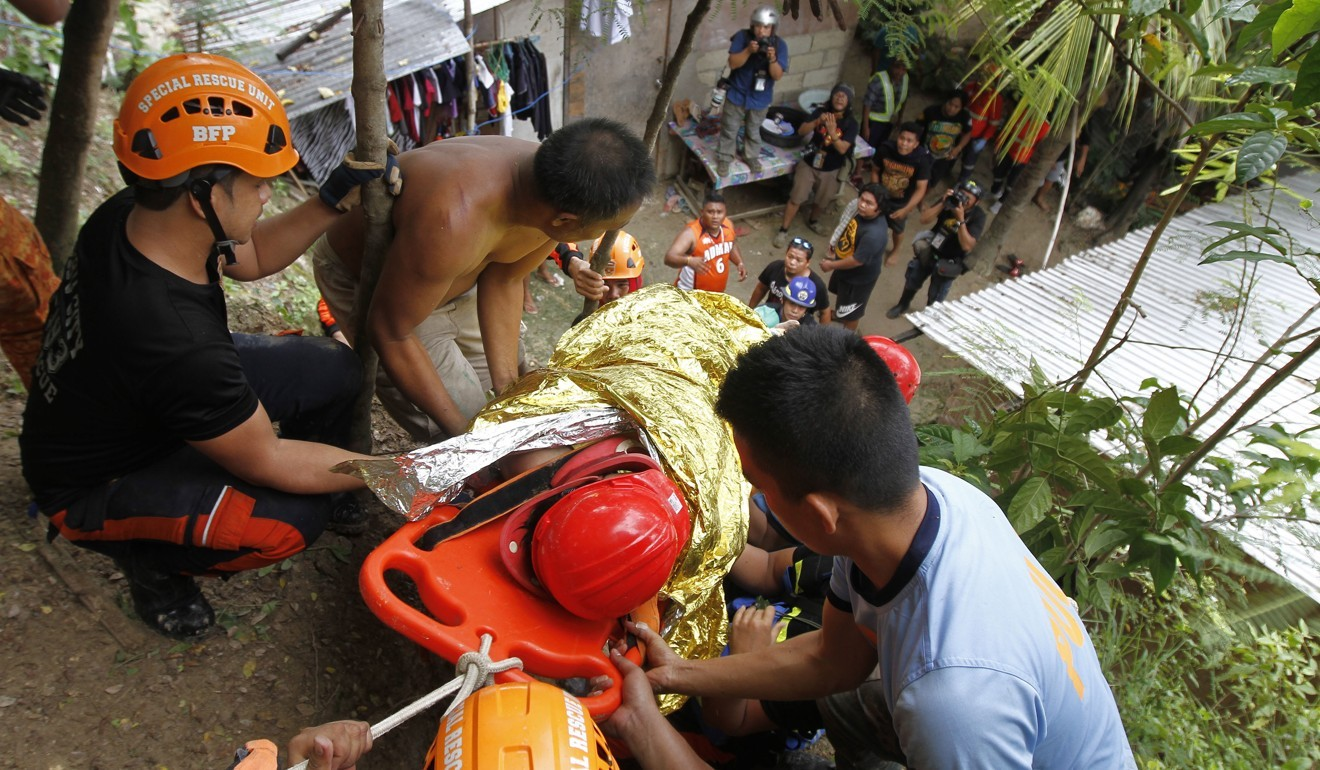 Rescuers dig for survivors after new landslide buries dozens