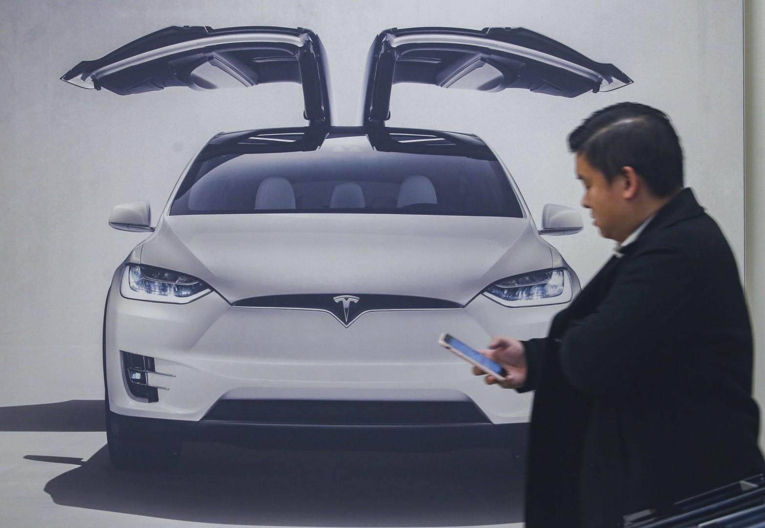 Will Tesla lose its cool in Hong Kong? Axa triples insurance