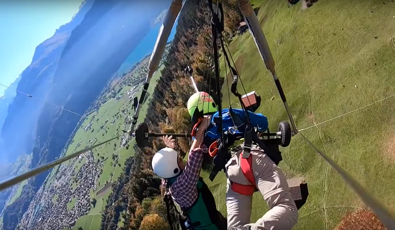 Video shows man hanging on for his life, after Swiss glider pilot