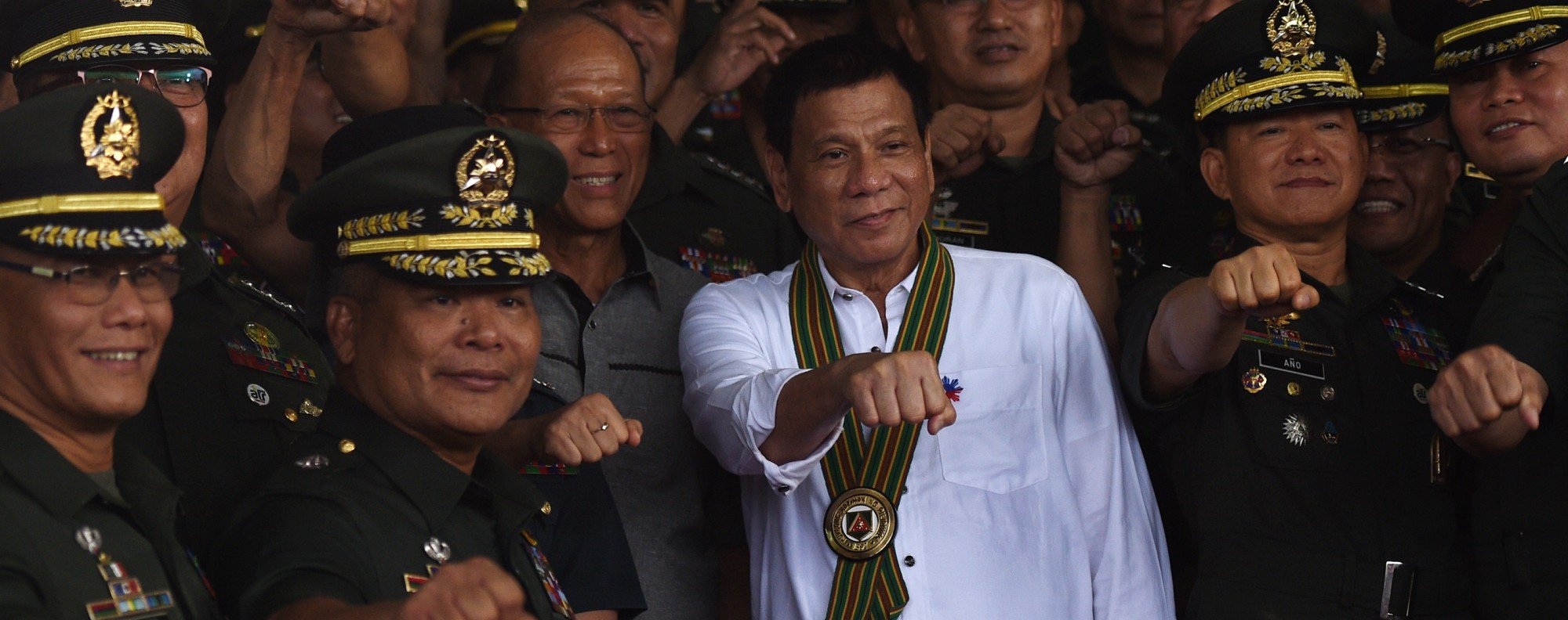 "Philippine President Rodrigo Duterte with military officers during a ""talk to the troops"" visit in Manila 2016."