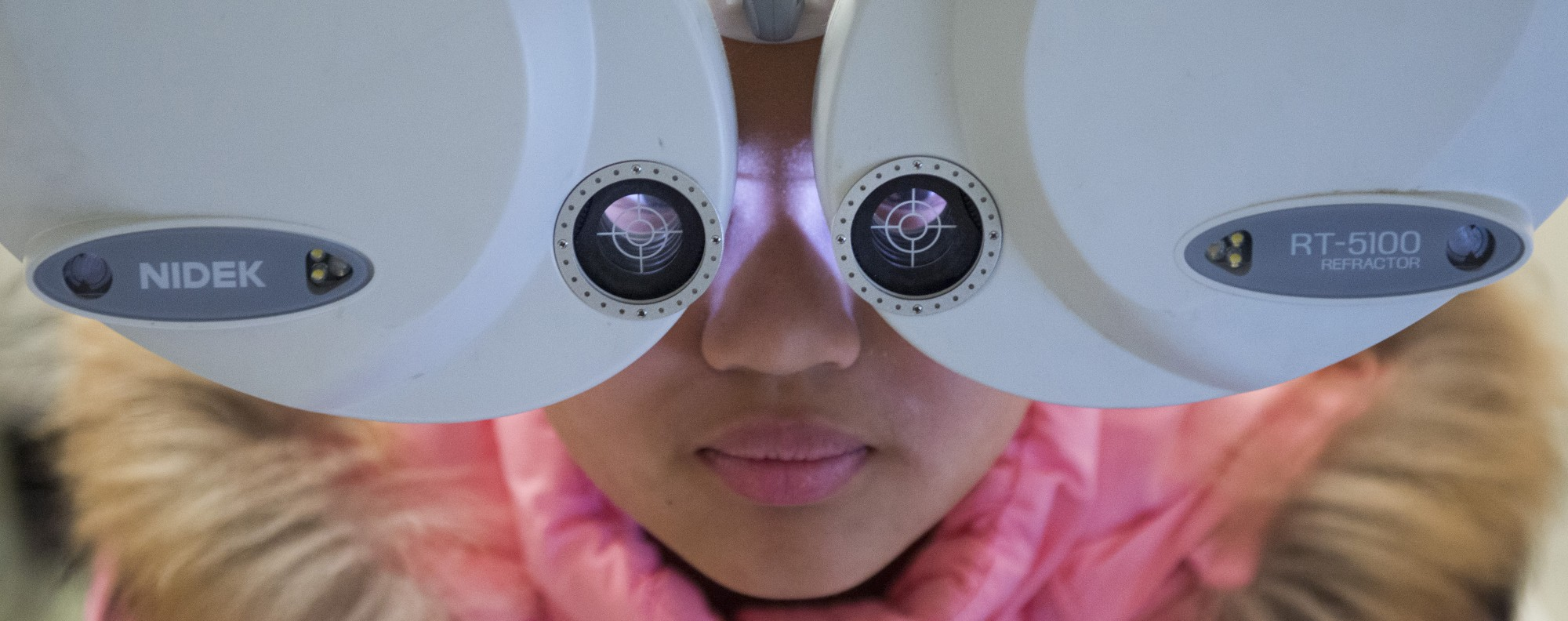 A girl has her eyes tested in Shanghai. Picture: Zigor Aldama