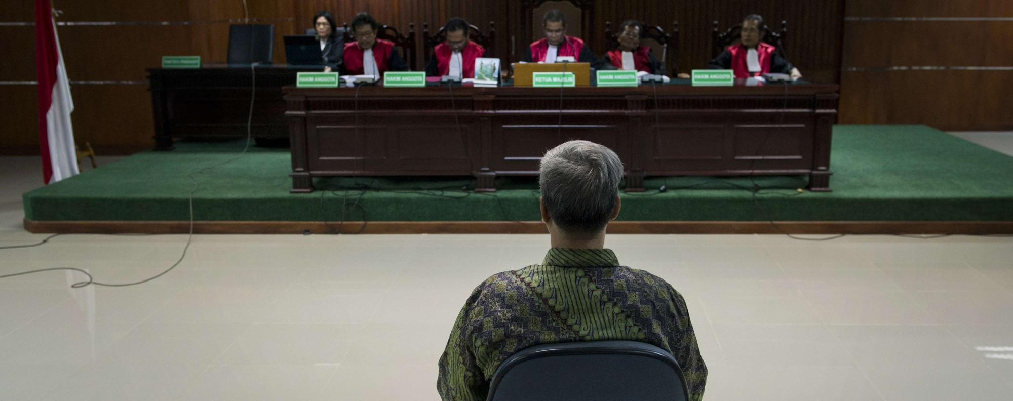 Former Constitutional Court chief justice Akil Mochtar on trial in 2014. Photo: AFP
