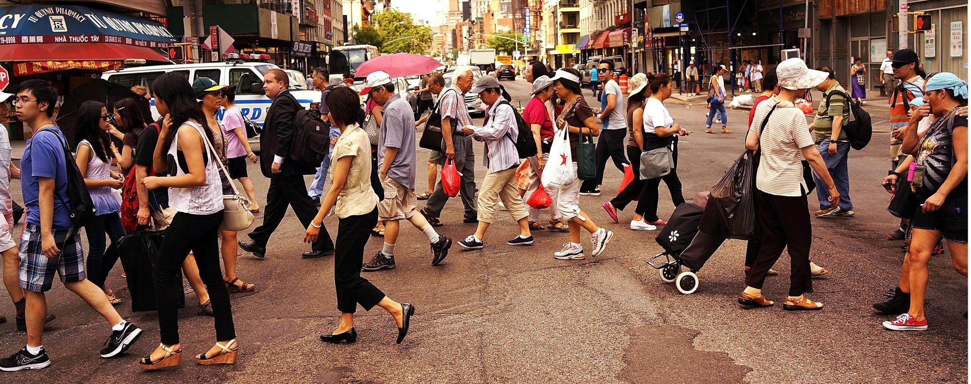 Pedestrians in New York's Chinatown. Photo: AFP