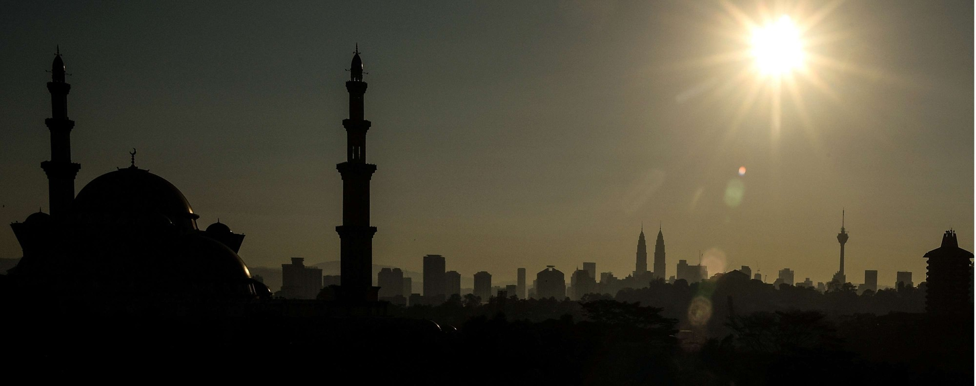 The sun rises over Kuala Lumpur. Photo: AFP