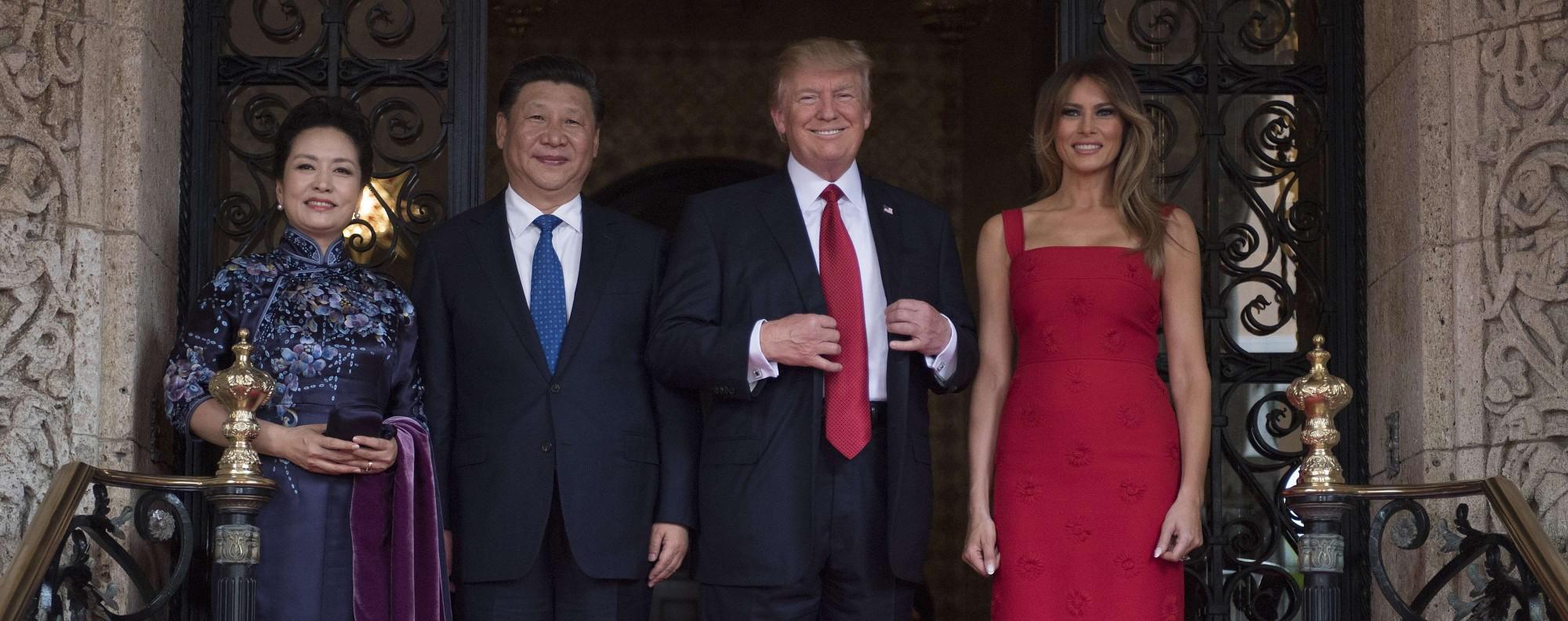 Xi and Trump with wives Peng Liyuan and Melania. Photo: AFP
