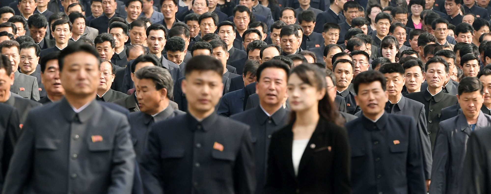 North Koreans visit Mansu Hill in Pyongyang. Photo: Kyodo