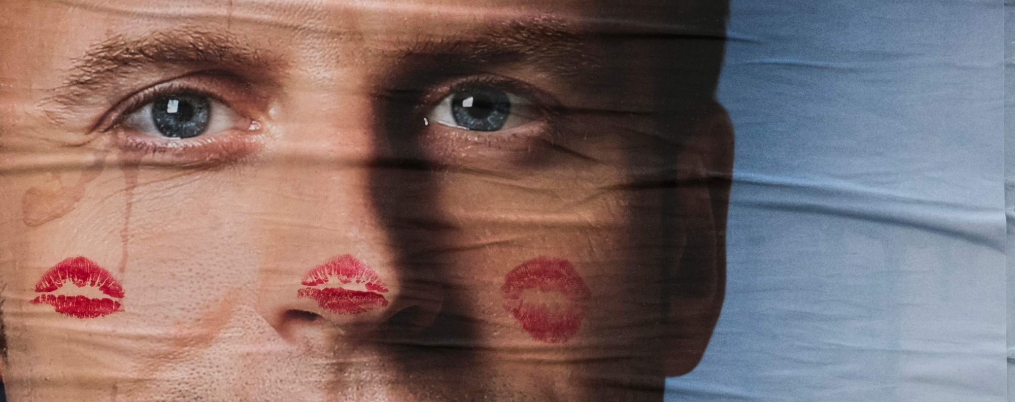 A vandalised Macron campaign poster. Photo: AFP
