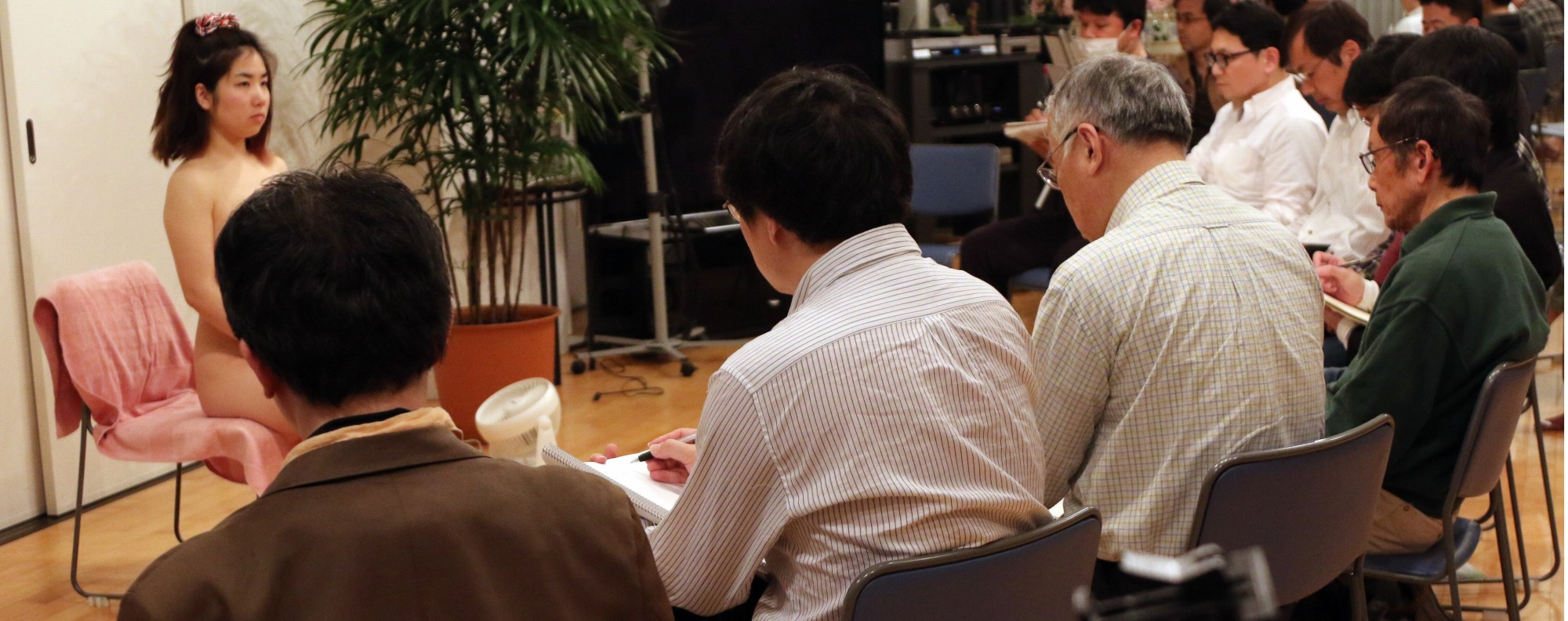 Middle aged Japanese men at a life drawing class. Photo: AFP