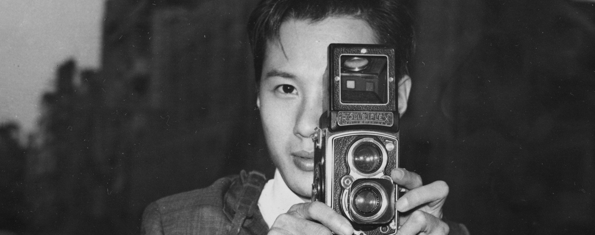 Fan Ho with his Rolleiflex 3.5 A (type K4A) camera.