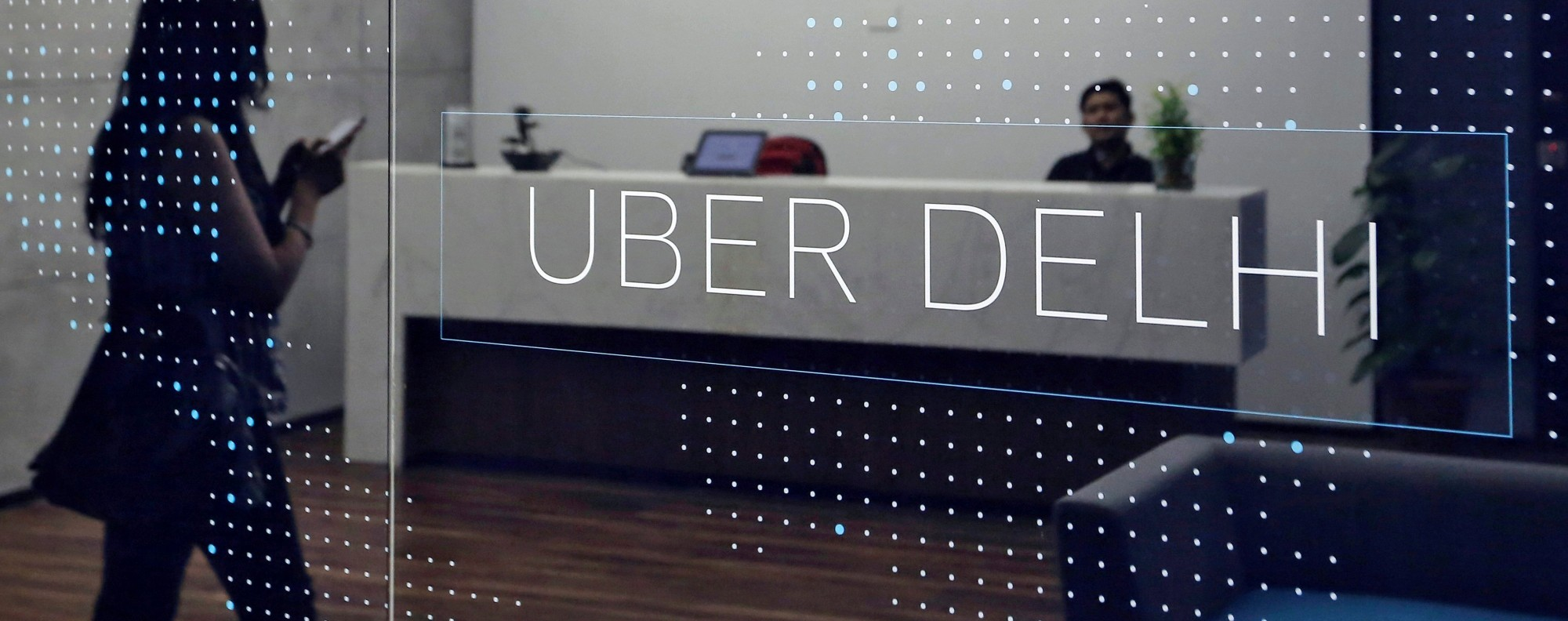 An employee walks in Uber's New Delhi office. Photo: Reuters