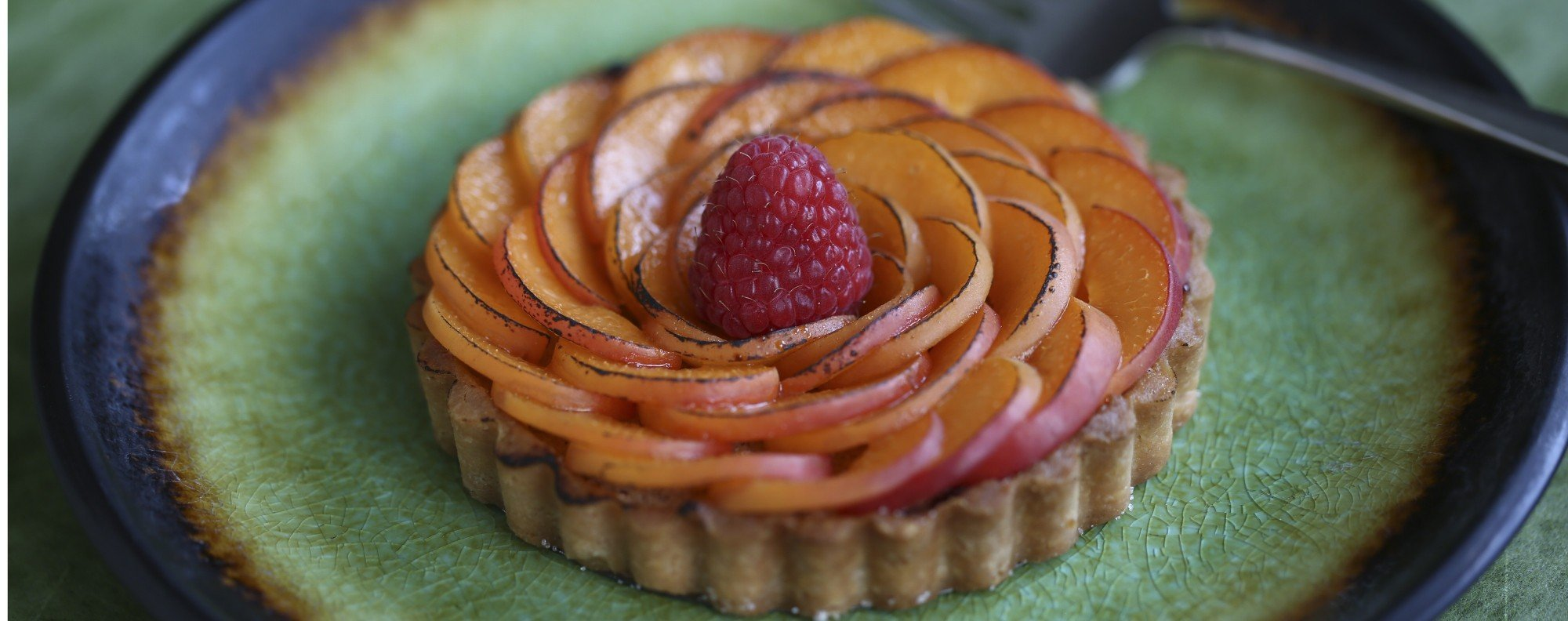 Apricot and raspberry tarts with almond filling. Photography: Jonathan Wong