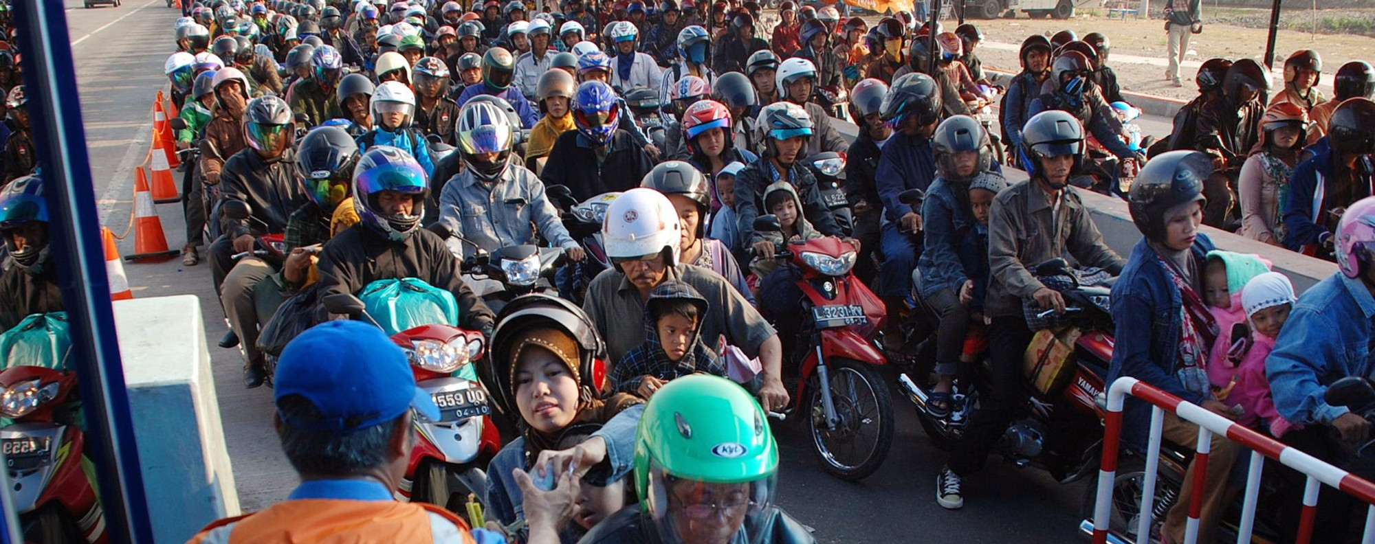 Motorists queue at a toll gate in Surabaya, Indonesia. Photo: AFP