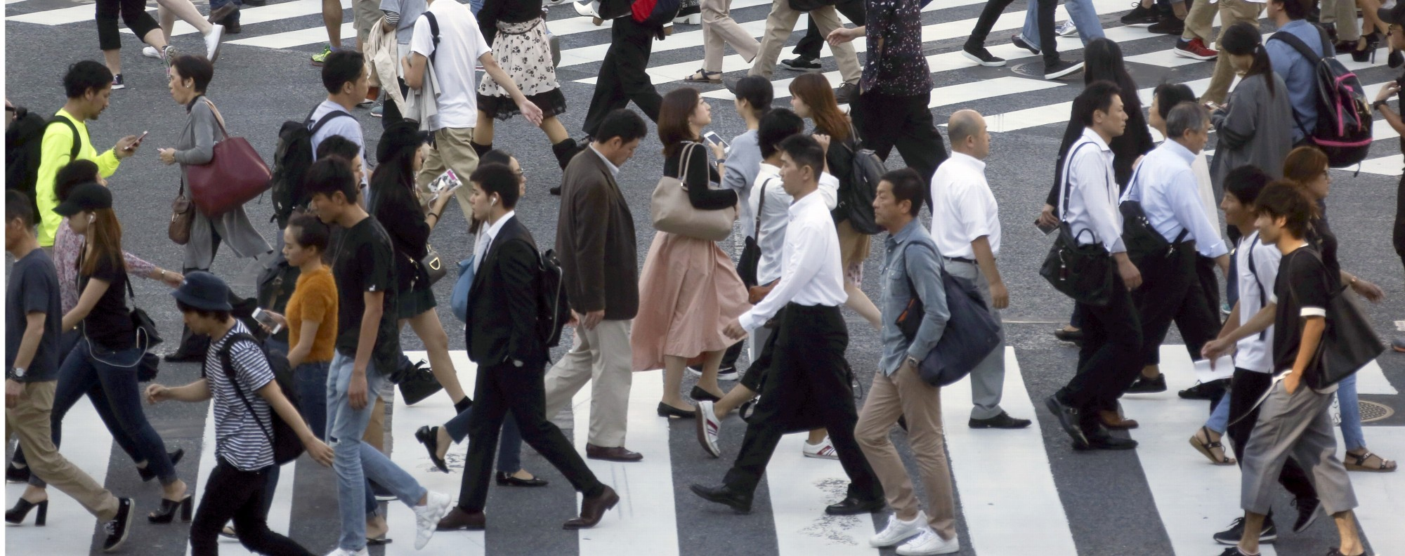 People cross streets at Tokyo's shopping and entertainment district of Shibuya. Photo: AP