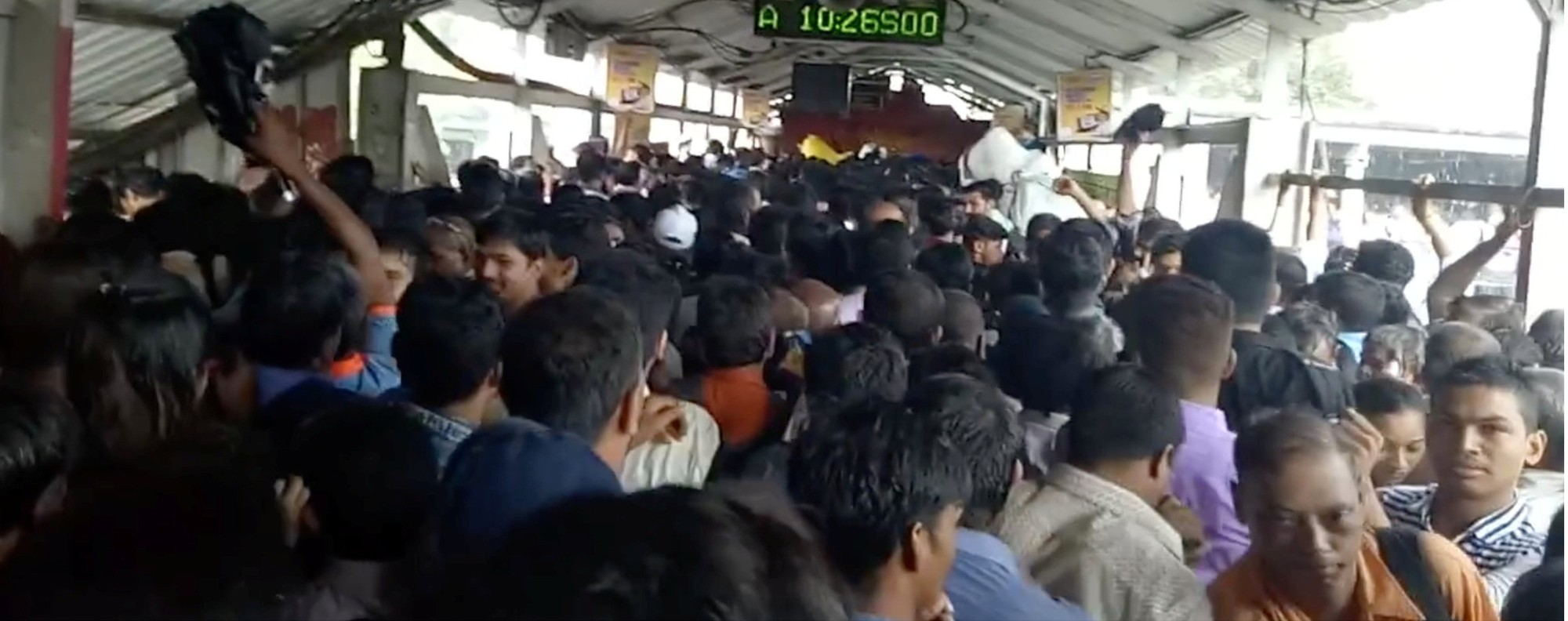 Commuters on the Elphinstone bridge around the time of a stampede. Photo: Reuters